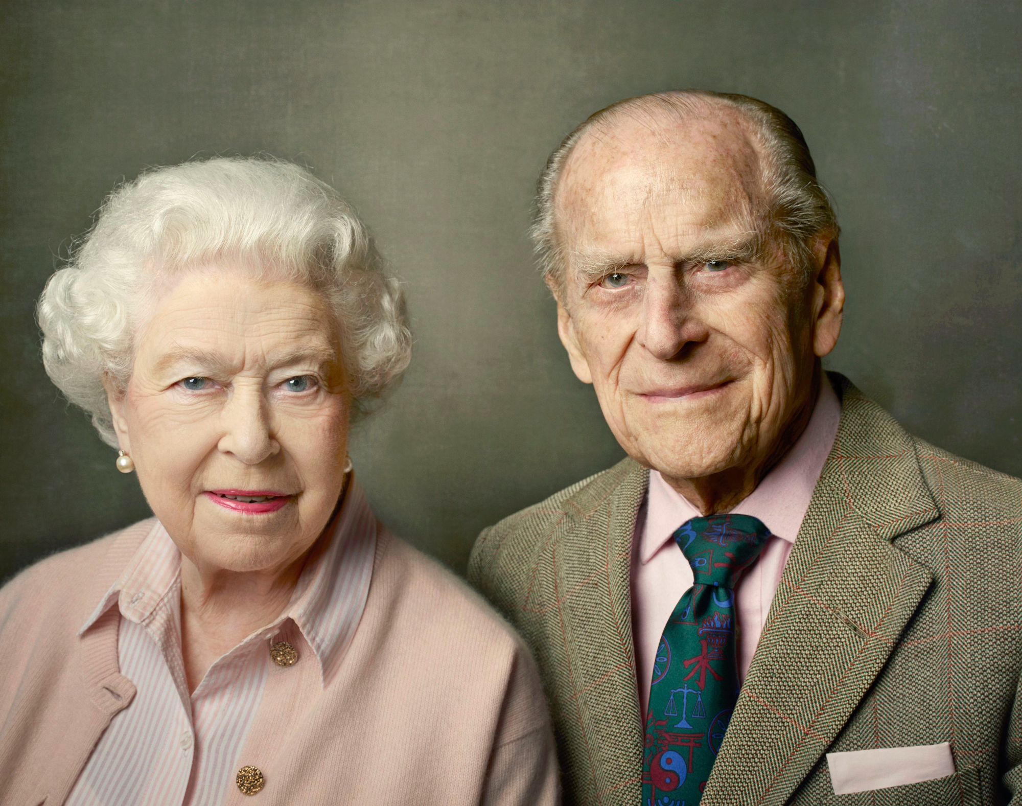 In this undated photo released by Buckingham Palace on Friday, June 10, 2016, Britain's Queen Elizabeth II, left and Prince Philip, the Duke of Edinburgh pose for a photograph to mark the Queen's 90th birthday, in Windsor, England. The queen, Britain's ol