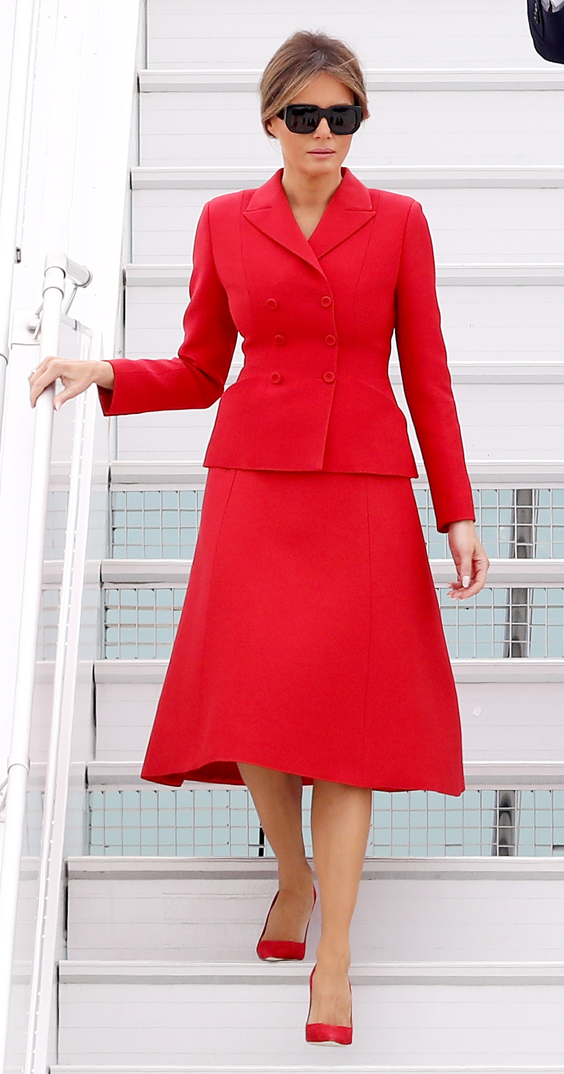 Melania Trump Wears Red Dior Skirt Suit to Meet the First Lady of France