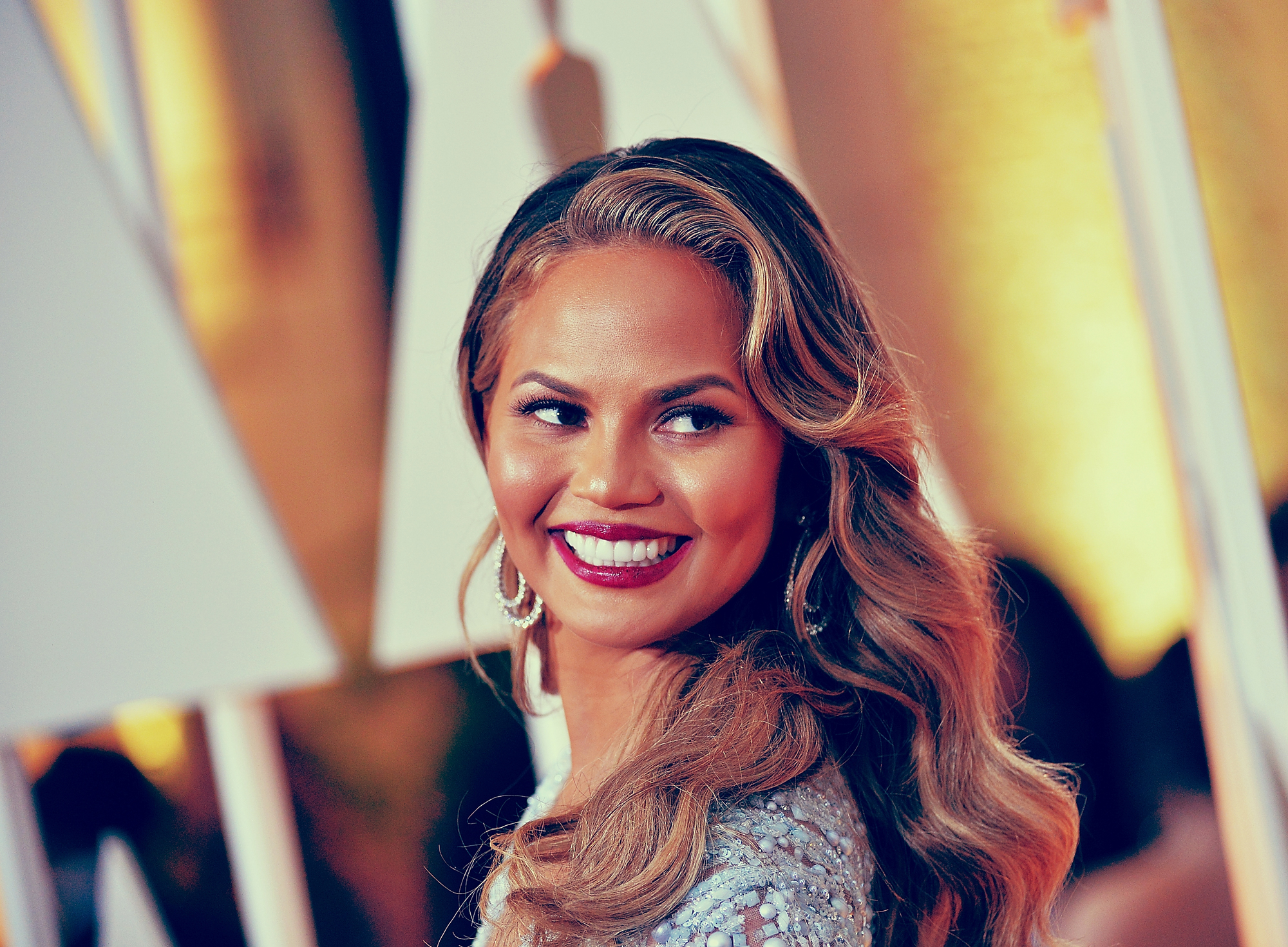 Watch Chrissy Teigen Try to Get Out of Revealing Who Bit Beyoncé
