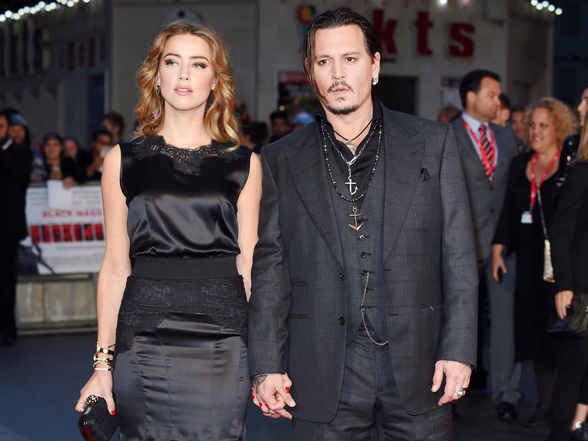 "Johnny Depp Just Changed His Amber Heard Tattoo Again—This Time from ""Scum"" to ""Scam"""
