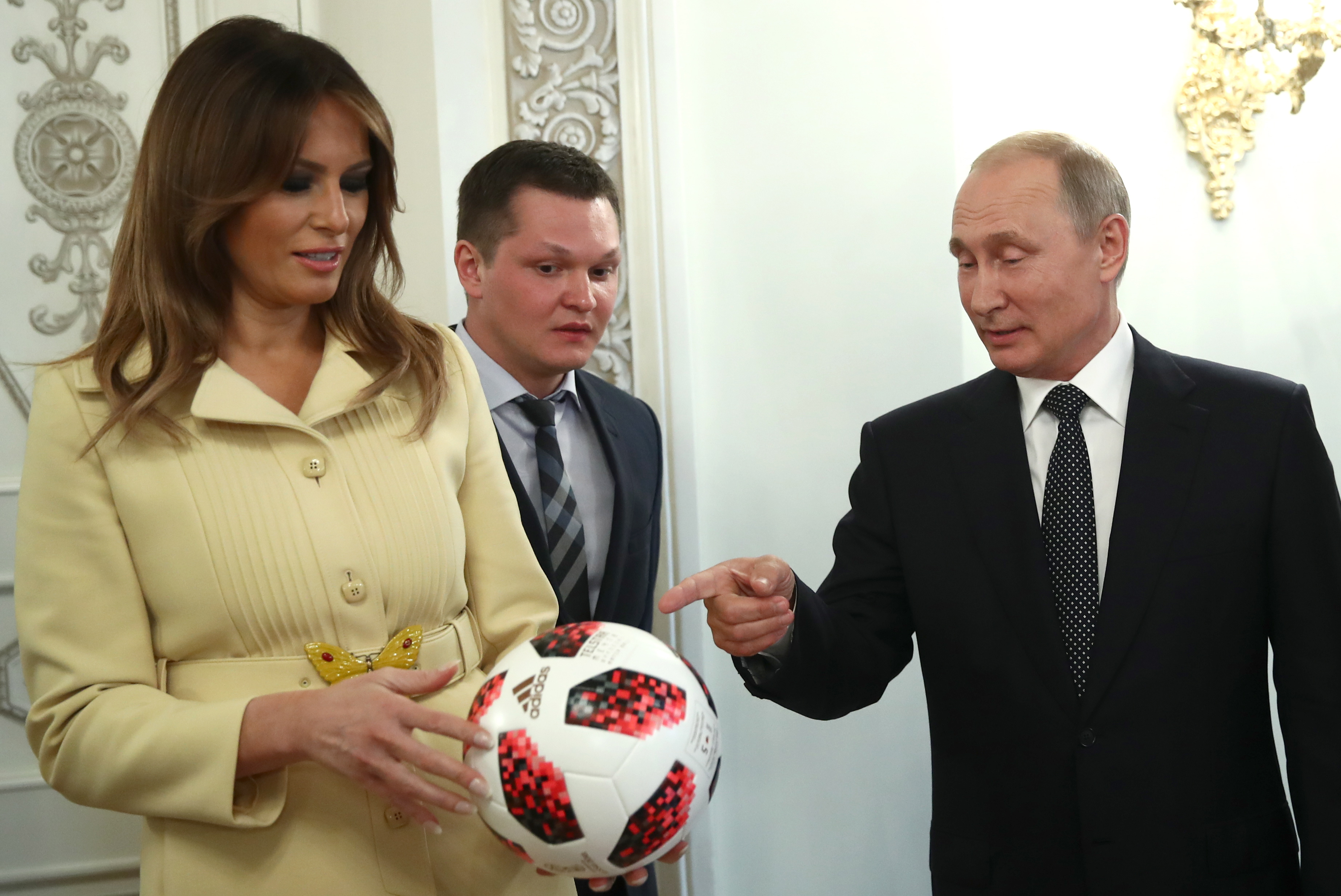 Watch Donald Trump Throw Vladimir Putin's Soccer Ball at Gucci-Clad Melania