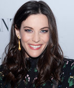 Liv Tyler Shows Off Her Baby Bump in the Cutest Cropped Overalls Ever