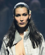 Bella Hadid Owns the amfAR Runway in a Super Sexy Silver Tracksuit