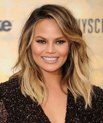 Chrissy Teigen Channels Pinup-Glam in a Sexy Plunging Swimsuit, Gets Wild with Luna on Snapchat