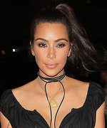 Kim Kardashian West Shows Off Her Incredibly Tiny Waist in a Sexy Black Corseted Ensemble