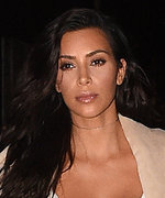 Kim Kardashian Is White-Hot in a Plunging Top and Denim Miniskirt
