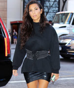 Kim Kardashian West Rocks a Sweatshirt and Leather Corset to Take North West to the Movies