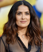 Salma Hayek Flaunts Her Fit Physique in a Pink Bikini While Riding a Swan Floatie