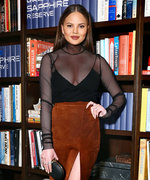 Chrissy Teigen Goes Daring in a Mesh Top and a Skirt with a Thigh-High Slit