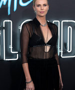 Woman of the Week: Charlize Theron Is All About The F**K You Bra Tops And Teeth-Shattering Stunts