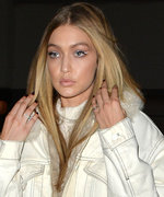 Gigi Hadid Flaunts Black Lingerie Underneath a Frozen-Inspired Getup