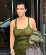 Kim Kardashian Highlights Her Budding Baby Bump in a Military-Inspired Look