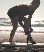 Watch This Incredible Pro Surfer Ride Waves in a Dress and High Heels