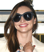 Miranda Kerr Demos How to Tastefully Wear a Minidress at the Airport