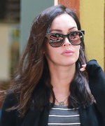 Megan Fox Shows Off Her Baby Bump in a Curve-Hugging Striped Dress