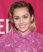 Miley Cyrus Cuddles with Liam Hemsworth's Dog in Fresh-Faced Selfie