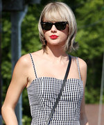 Taylor Swift Returns to Her Classic Style in a Gingham Dress and Red Lip