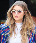Gigi Hadid Effortlessly Beats the N.Y.C. Heat in a Bright Striped Suit
