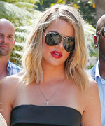 Khloé Kardashian Displays Her Svelte Figure in a Strapless Jumpsuit