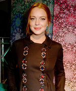 Lindsay Lohan Flaunts Her Enviable Figure in a Low-Cut Bodysuit