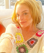 Lindsay Lohan Looks Blissful in a Fresh-Faced Selfie and Posts the #TBT of the Year