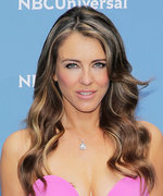 "Elizabeth Hurley Wears a Striped Bikini to Soak Up the ""Last Rays of Summer"""