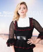 Newly Single Chloë Grace Moretz Blows Kisses in Festive Frilly Number