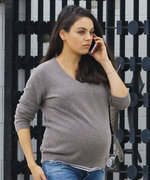 Mila Kunis Shows Off Her Baby Bump in a Cozy Gray Sweater and White Sneakers
