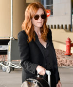 Julianne Moore Tops Off Her Elegant Suit with Louis Vuitton Monogram Backpack at Vegas Airport