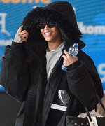 Rihanna Goes Incognito at JFK Airport in Oversize Fur Parka and Baggy Jeans