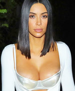Kim Kardashian Flaunts Her Curves in Sheer Bike Shorts