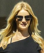 Rosie Huntington-Whiteley Highlights Her Baby Bump in a Fitted LBD