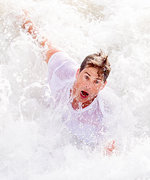 9 Hilarious Photos of Celebs Getting Crushed by Waves