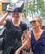 8 Hilarious Photos of Celebrities Getting Caught in the Rain