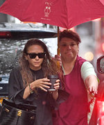 Mary-Kate Olsen Battles the Elements Alongside Her Umbrella-Holder