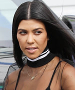 Kourtney Kardashian Plays Peekaboo in a Sheer Top and Bra While Running Errands in L.A.