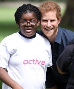 These Photos of Prince Harry Playing with Kids in London Will Melt Your Heart