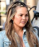 Pregnant Chrissy Teigen Paired a Crop Top with the Cutest Wrap Skirt