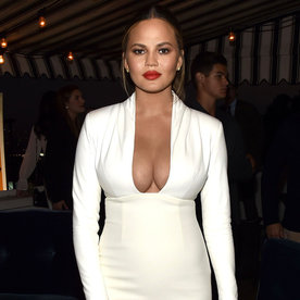 Chrissy Teigen Bares Her Assets in Plunging All-White Ensemble