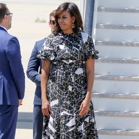 Michelle Obama Leaves Spain Alongside Her Daughters in a Cool Ruffled Frock