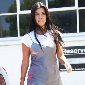 Kourtney Kardashian Flaunts Her Toned Gams in a Super Short Slip Dress