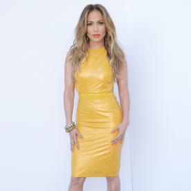 No One Can Pull Off Tangerine Lips and the Color Mustard Quite Like Jennifer Lopez