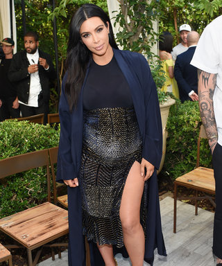 Kim Kardashian Shows Off Her Baby Bump in a Thigh-High Slit Skirt