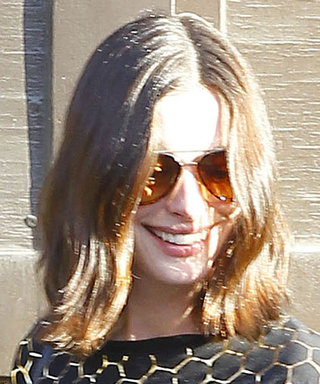 Anne Hathaway Shows Off Her Growing Baby Bump in a Printed Top