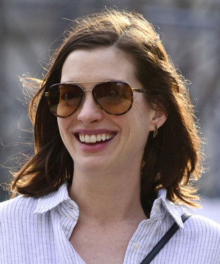 Anne Hathaway Rubs Growing Baby Bump While Out with Parents in N.Y.C.