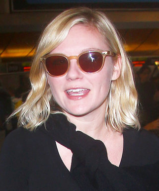 Kirsten Dunst Proves That Standout Travel Accessories Are a Must