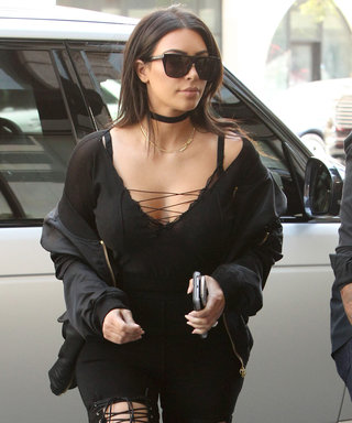 Kim Kardashian's Thigh-High Lace-Up Boots and All-Black Look Will Mesmerize You