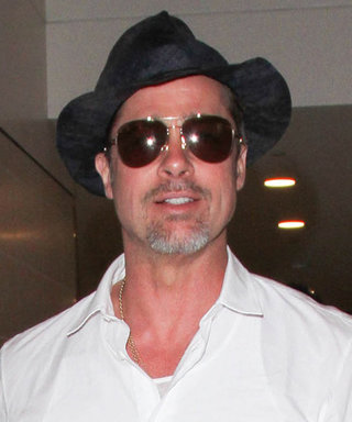 Brad Pitt Dares to Rock an All-White Outfit While Traveling