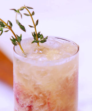 See How EyeSwoon's Athena Calderone Mixes Up a Peach Bourbon Fizz