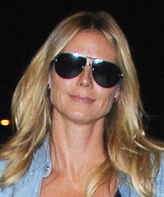 Heidi Klum Jet-Sets Out of LAX in a Double Denim Look